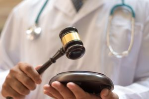 Forensic,Medicine,Concept.,Pathologist,Doctor,Holding,Hammer,Court,As,Investigation